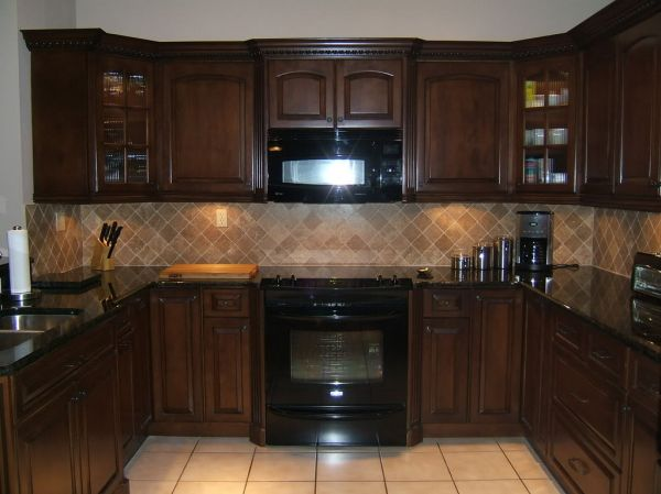 Modern Kitchenette With Wicked Wood Cabinets And Hardwood Floors