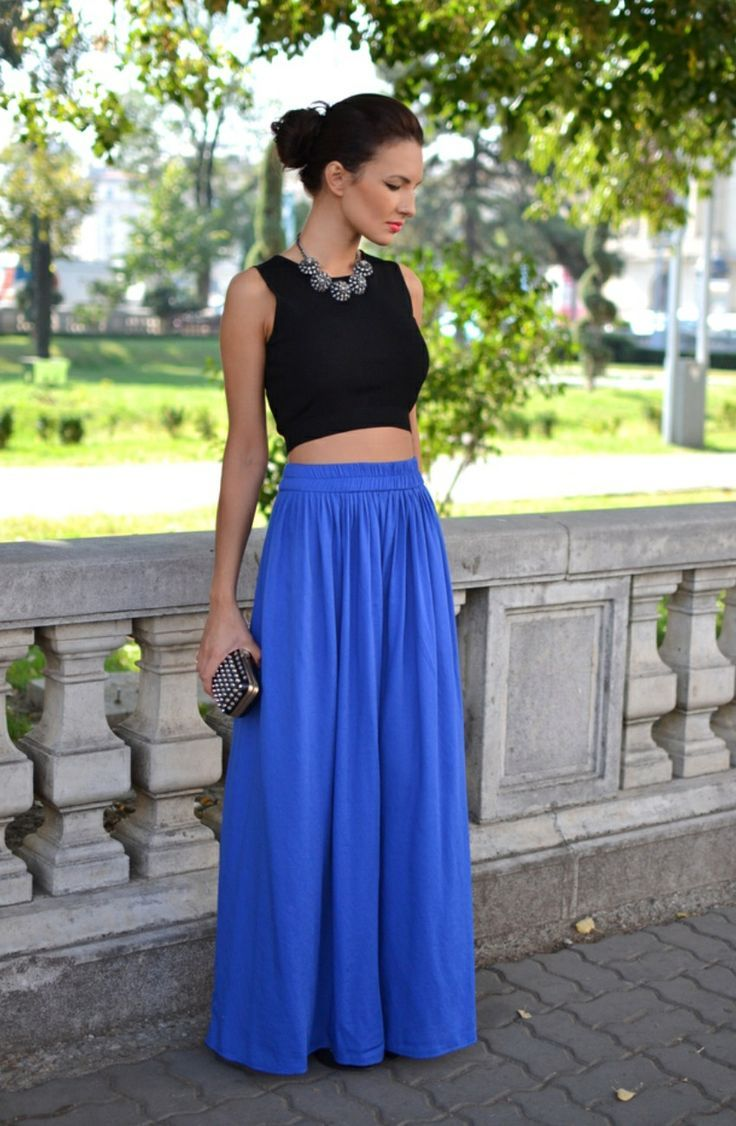 A ruffle trim adds flirty flow to a hi-lo maxi skirt that's constructed from a stripe challis fabric.