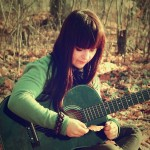 Girl_with_guitar_-_+7_DataBase