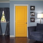 Interior_Bright_Yellow_Door_Grey_Corner_Chair_Some_Picture_Frames_-_Pooja_Room_Glass_Door_Designs_Images,_Pooja_Room_Door_Design