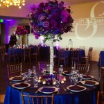 Purple_and_Blue_Wedding_Color_Theme._._Blue_linens_with_centerpieces_of_blue_and_purple_flowers._._Dark_brown_chiavari_chairs._